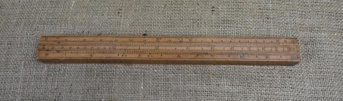 """12"""" four slide gauger's rule."""